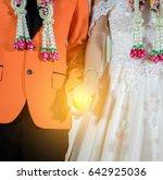 bride and groom join hands in...   Shutterstock . vector #642925036