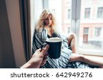 girl sitting on a window in a... | Shutterstock . vector #642949276