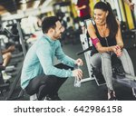 young woman exercise in a gym... | Shutterstock . vector #642986158