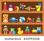 kids toys on wood shop shelves. ... | Shutterstock . vector #642992038