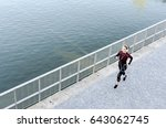 up view of a woman running and... | Shutterstock . vector #643062745