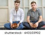two men sitting on the sidewalk ... | Shutterstock . vector #643103902