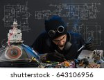 the man is engaged in repair of ... | Shutterstock . vector #643106956