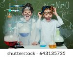 little kids in white coats with ... | Shutterstock . vector #643135735