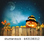Stock photo halloween pumpkin head jack lantern on wooden fence 643138312
