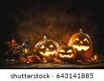 Stock photo halloween pumpkin head jack lantern with burning candles 643141885
