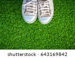 close up of white sneakers on... | Shutterstock . vector #643169842