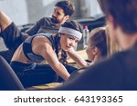 sporty young people lying on... | Shutterstock . vector #643193365