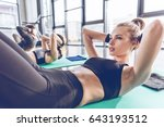 sporty young people lying on... | Shutterstock . vector #643193512