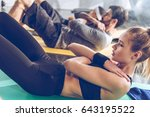 sporty young people doing abs... | Shutterstock . vector #643195522