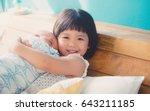 little sister hugging and... | Shutterstock . vector #643211185