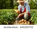 farmer show his organic potato... | Shutterstock . vector #643232722