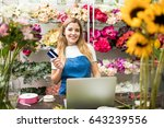 sweet flower shop owner holding ...   Shutterstock . vector #643239556