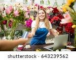 beautiful hispanic flower shop... | Shutterstock . vector #643239562