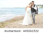 happy bride and groom walking... | Shutterstock . vector #643261522