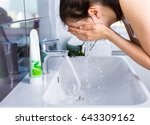 woman washing up in the morning.... | Shutterstock . vector #643309162