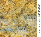 Small photo of Seamless abstract background. Layers of wet clay and sand light shades on the side of a cliff. The texture of the Devonian deposits of the closeup.