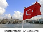 flag waving on an istanbul ferry | Shutterstock . vector #643358398