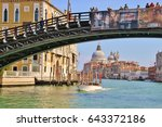 Small photo of Venice, Italy - April 4, 2017: The bridge ponte dell Academia on the Grand Canal, next to the Peggy Guggenheim museum, in the background the baroque church Santa Maria della Salute. Italy, Europe.