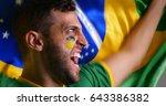 brazilian fan with brazilian... | Shutterstock . vector #643386382