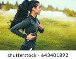 woman running on gravel road | Shutterstock . vector #643401892