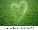 green grass heart background | Shutterstock . vector #643436092