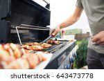 hand of young man grilling some ... | Shutterstock . vector #643473778