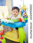 baby boy playing toy | Shutterstock . vector #643490002