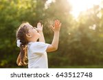 funny little girl catching soap ... | Shutterstock . vector #643512748