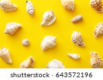 seashells pattern on a yellow... | Shutterstock . vector #643572196