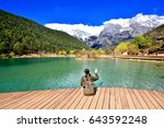 back of girl travel alone sit... | Shutterstock . vector #643592248
