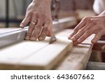 the joiner saws a piece of wood ... | Shutterstock . vector #643607662