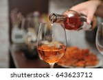 wine is poured into a glass | Shutterstock . vector #643623712