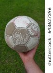 Small photo of Old ball of soccer in hand