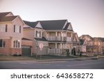 Small photo of friendly neighborhood subdivision, with many houses down a quiet street.