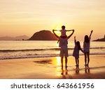 asian family standing on beach... | Shutterstock . vector #643661956