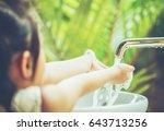 asian child washing hands | Shutterstock . vector #643713256