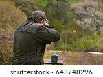 Gunman Shooting The Asphalt...