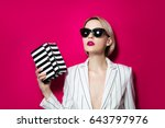 rich young woman in black... | Shutterstock . vector #643797976