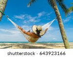 woman relaxing at the beach on... | Shutterstock . vector #643923166