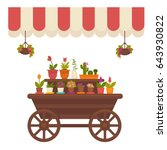 wagon with flowers in store | Shutterstock .eps vector #643930822