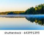 sunrise over the lake haukivesi.... | Shutterstock . vector #643991395