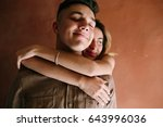 girl hugging guy from behind on ... | Shutterstock . vector #643996036