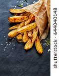 oven baked potato wedges with ... | Shutterstock . vector #644040148