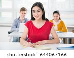 pretty female university... | Shutterstock . vector #644067166