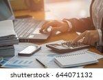 a business woman analyzing... | Shutterstock . vector #644071132