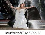 wedding couple near the fountain | Shutterstock . vector #64407778