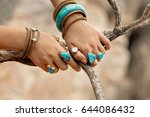 close up hands with boho... | Shutterstock . vector #644086432