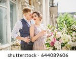 young  beautiful couple groom... | Shutterstock . vector #644089606