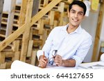 young man architect in office | Shutterstock . vector #644127655